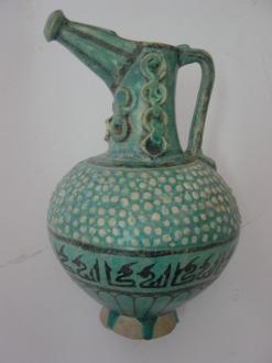 Ceramics - Ewer coated with a monochrome green glaze